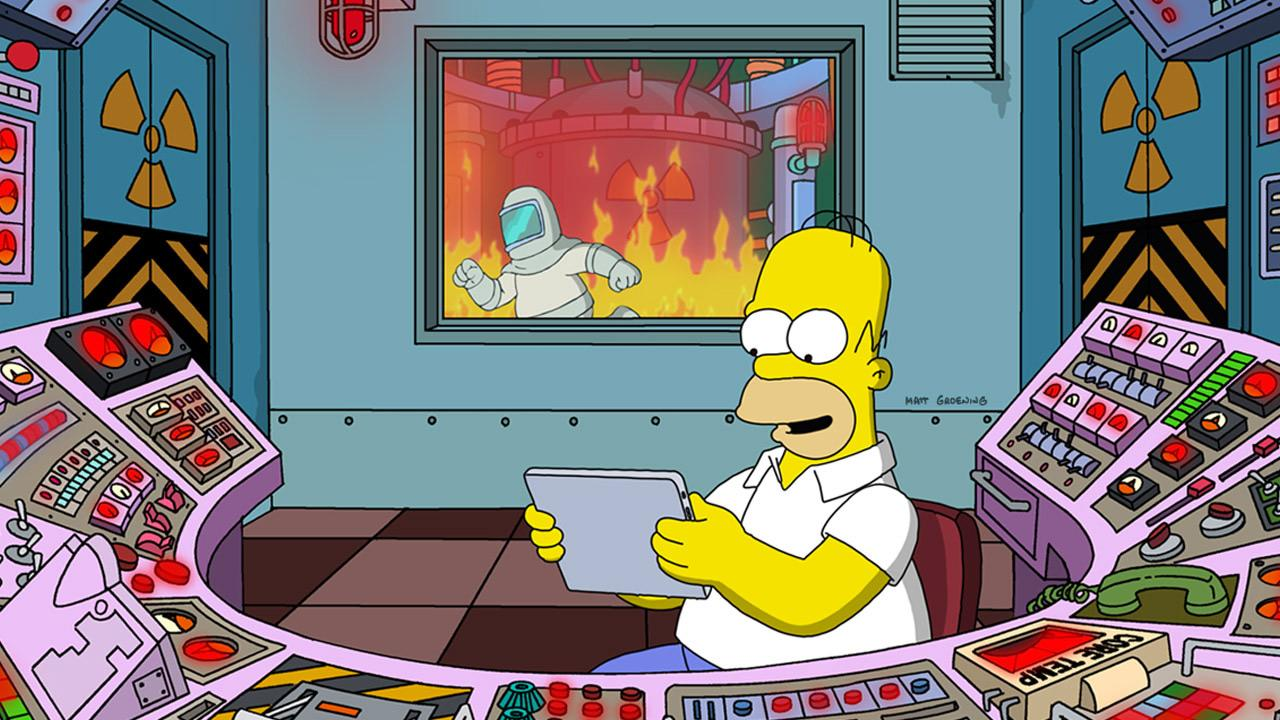 Homer fiddling on an ipad while the plant melts down